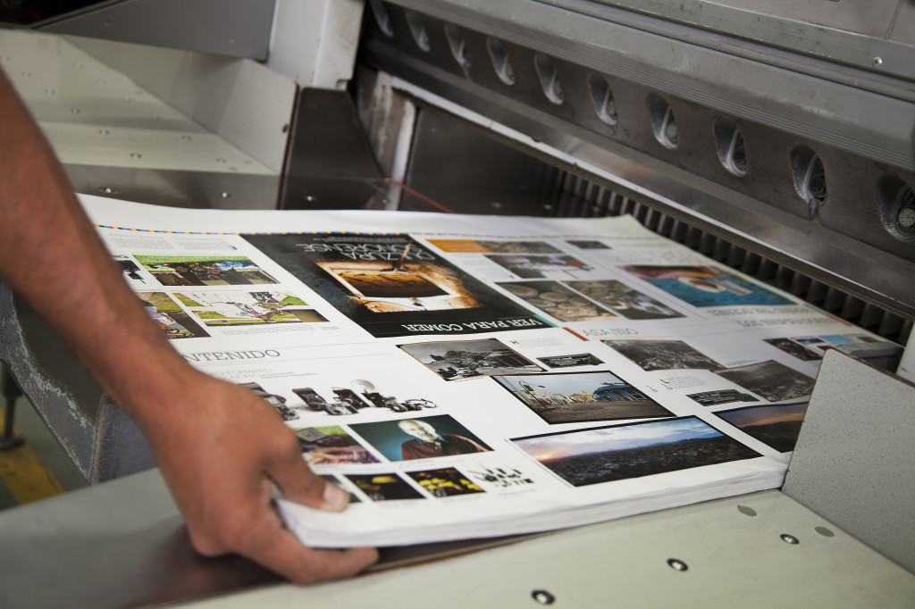 Photos being printed to large machine