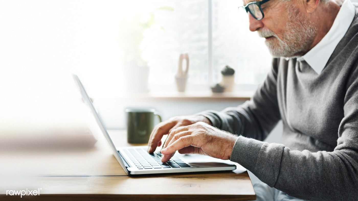 Old woman using a laptop