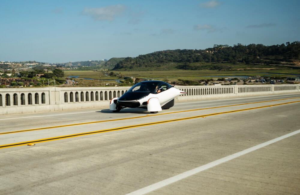 Aptera vehicle driving across bridge