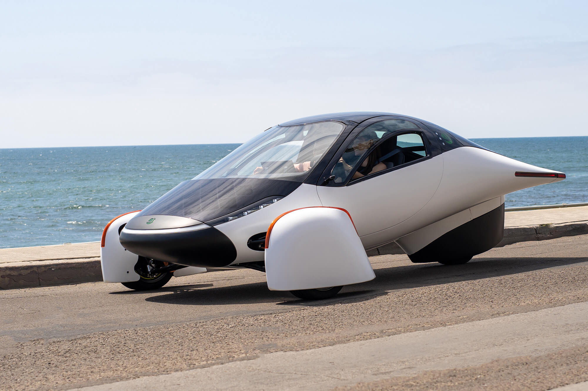 Aptera vehicle parked by the ocean