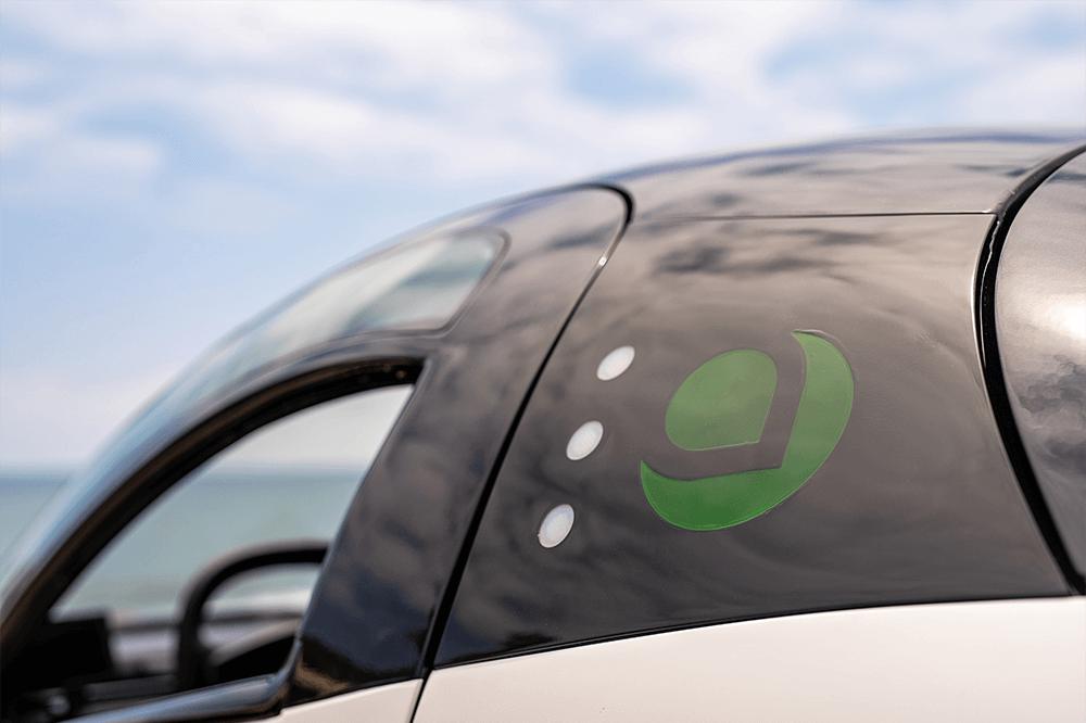 Aptera logo on the outside of a vehicle