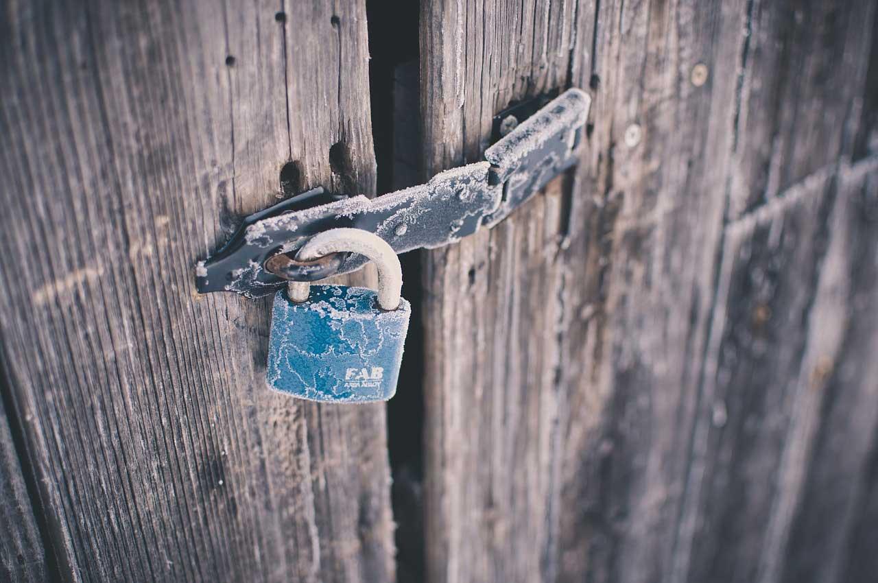 Blue rusted padlock
