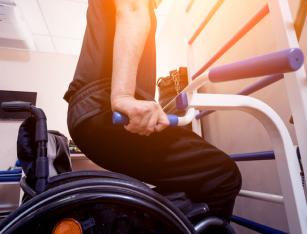 a man in a wheelchair exercising