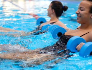 two women performing water aerobics