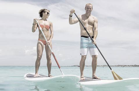 Couple paddle boarding off of Grace Bay beach