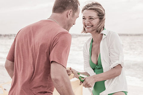 Couple smiling at each other on Grace Bay beach