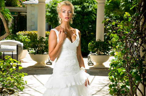 Woman in wedding dress standing in the courtyard