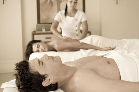 Couple enjoying a massage at the Spa at the Palms