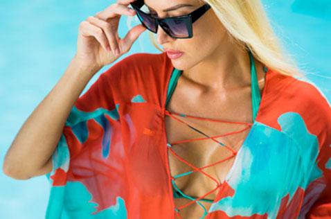 Woman in sundress wearing sunglasses
