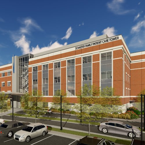 Architectural rendering of new Schaefer Family Care Tower, a six or seven story brick building with tall windows, cars in parking lot in front