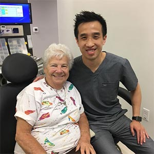 Blooming Family Dental Smiling Senior Patient with Dr. Chang