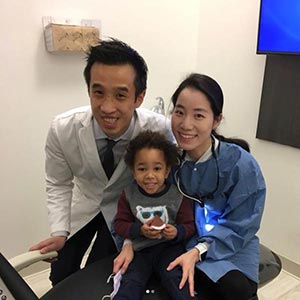 Blooming Family Dental Doctors and smiling kid in clinic