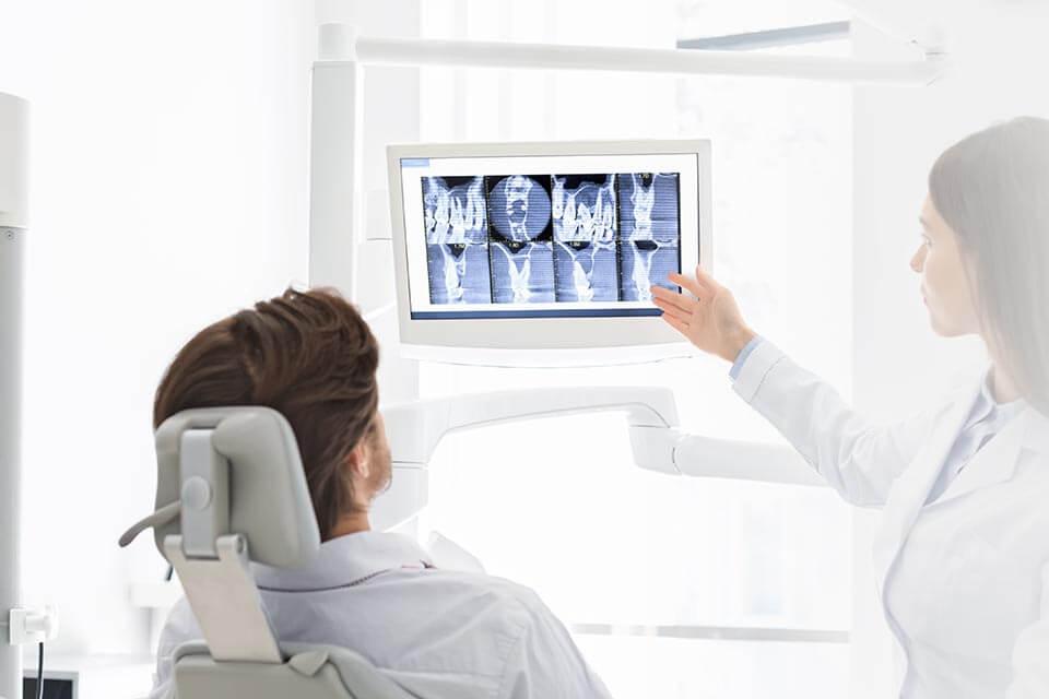Patient looking at screen displayin Digital X-rays
