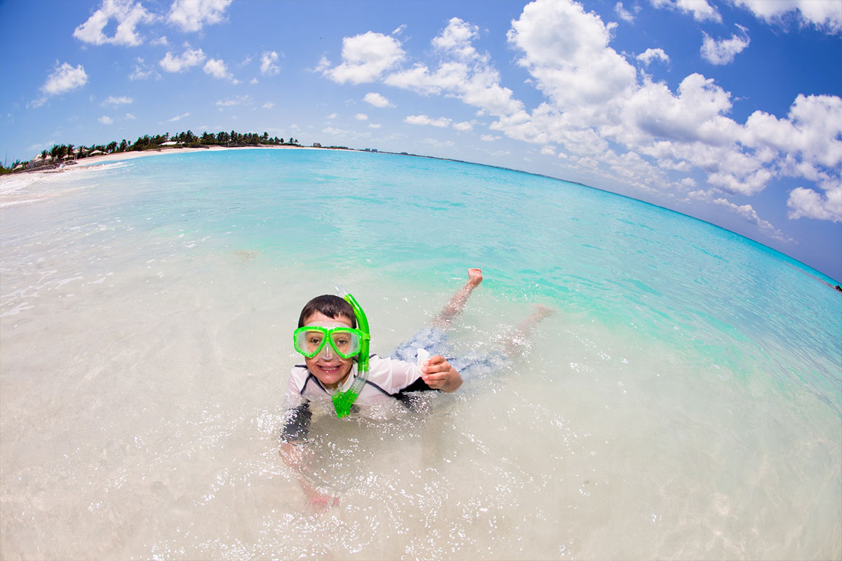 Children love to snorkel in the clear blue water