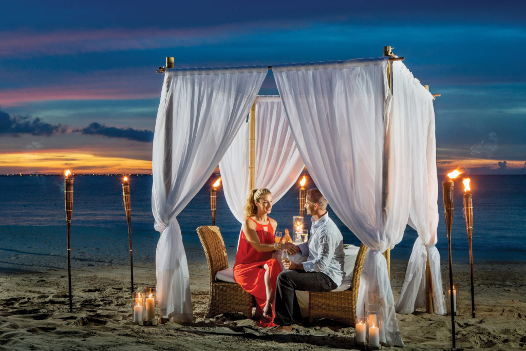 Couple dining on grace bay beach at The Palms
