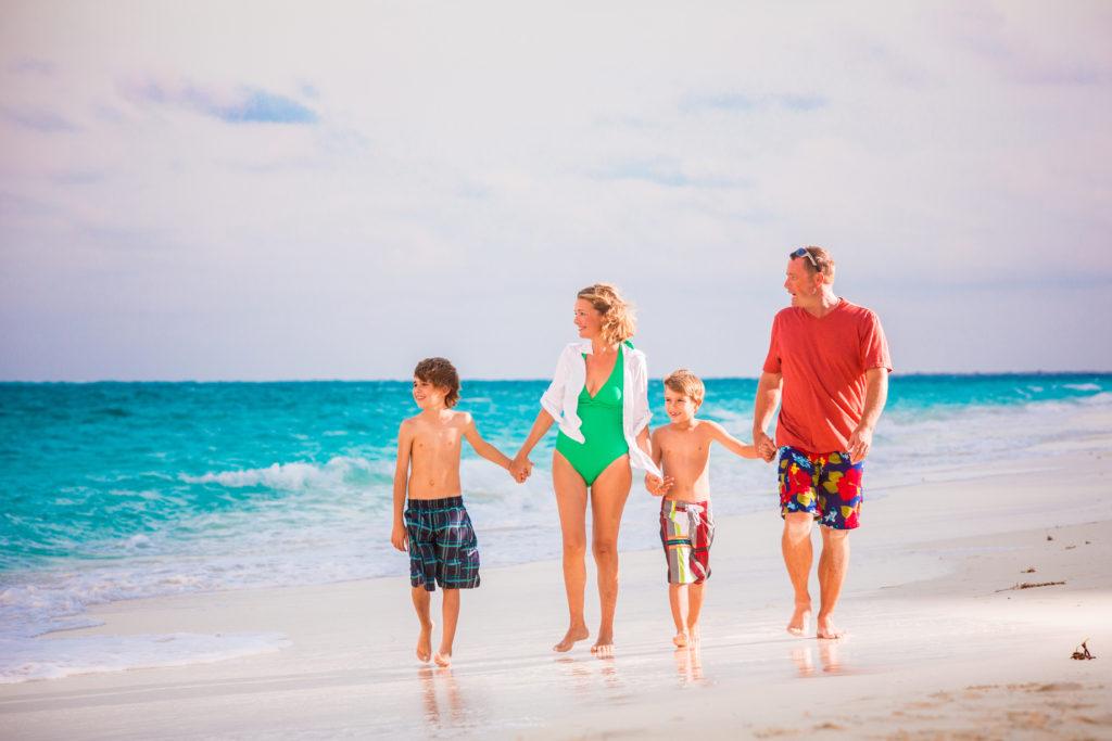 Family walking on grace bay beach