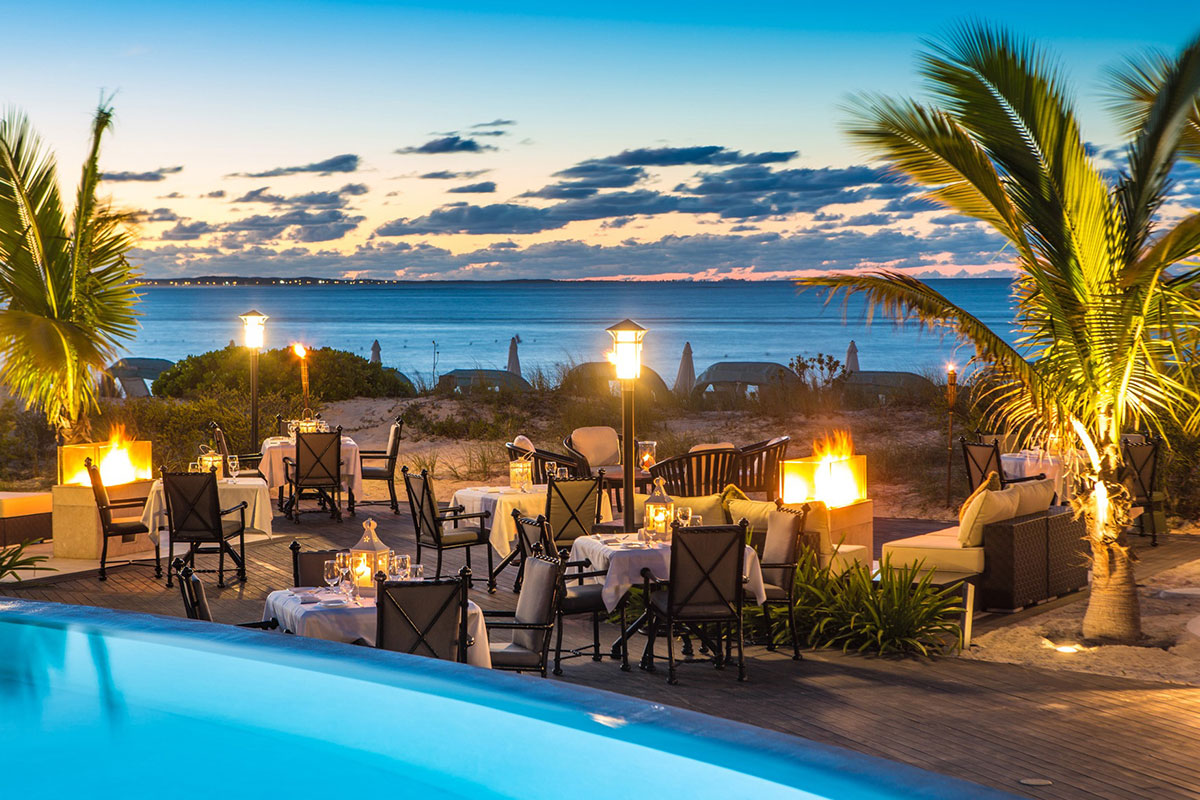Dining poolside with beach views at The Palms Turks and Caicos