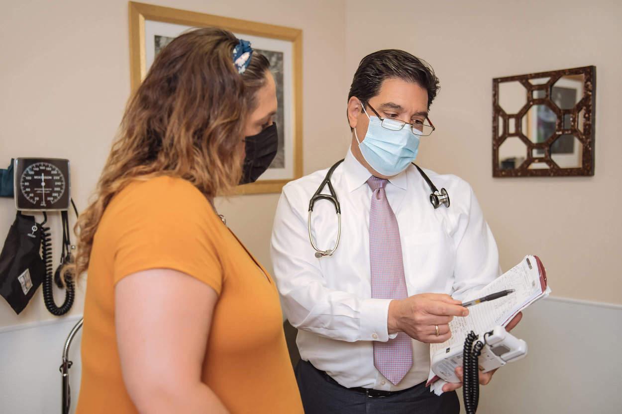 Dr. de la Peña talking with patient
