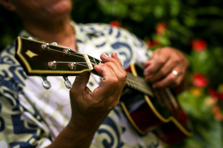 Person playing ukulele.