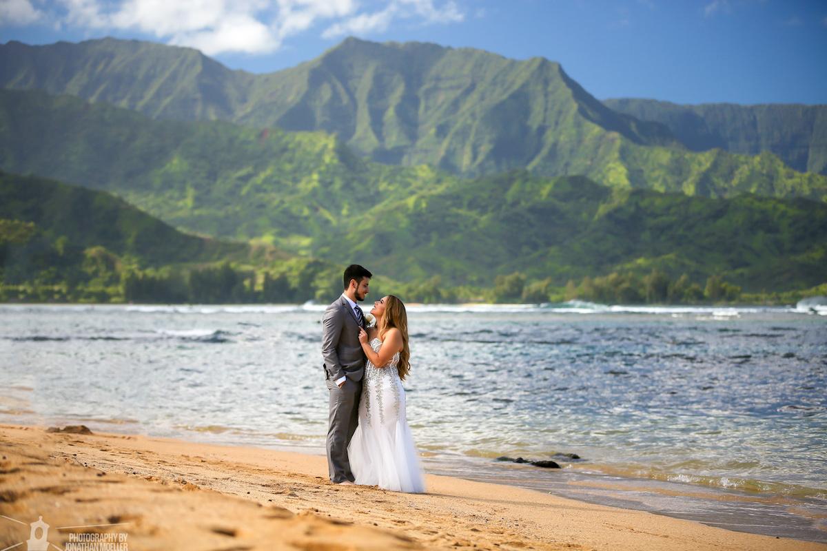 Couple on the beach in Hanalei Bay.