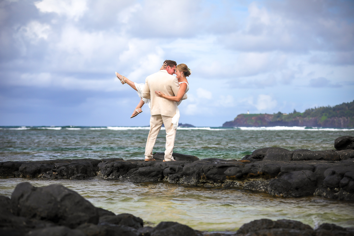 Couple in the tide pools on Anini.