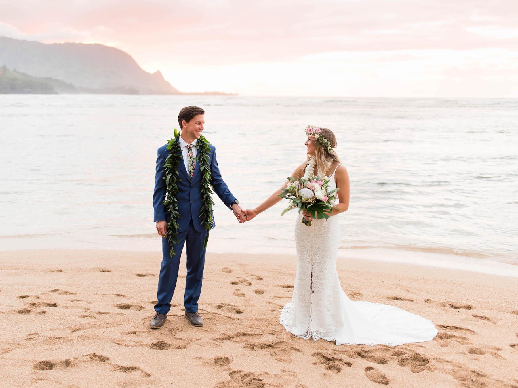 Couple eloping on a beach in Kauai.