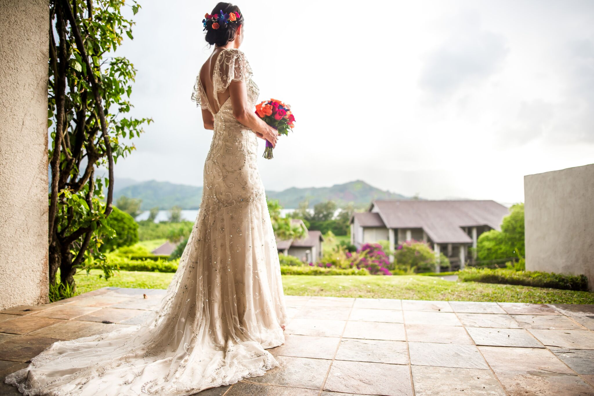 Bride with flowers looking away.