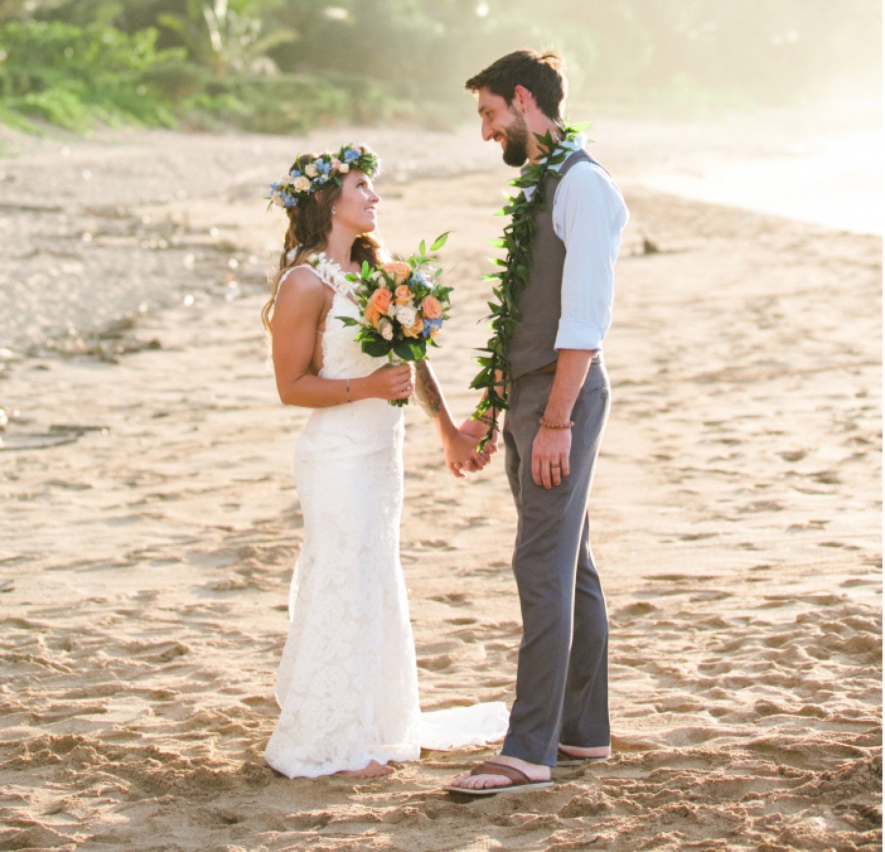 Couple getting married on the beach in Hawaii.