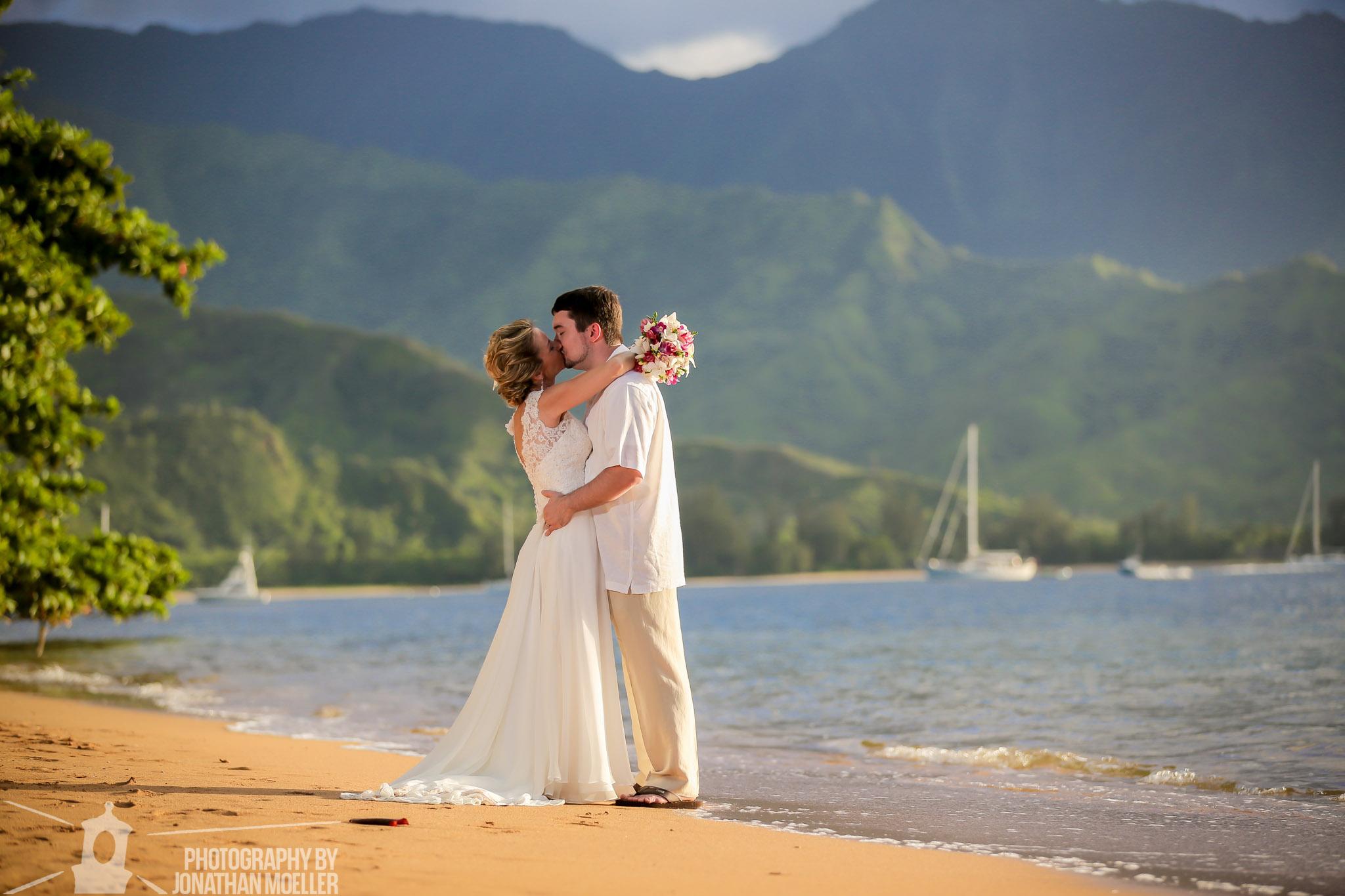 Couple embracing on Puu Poa Beach.