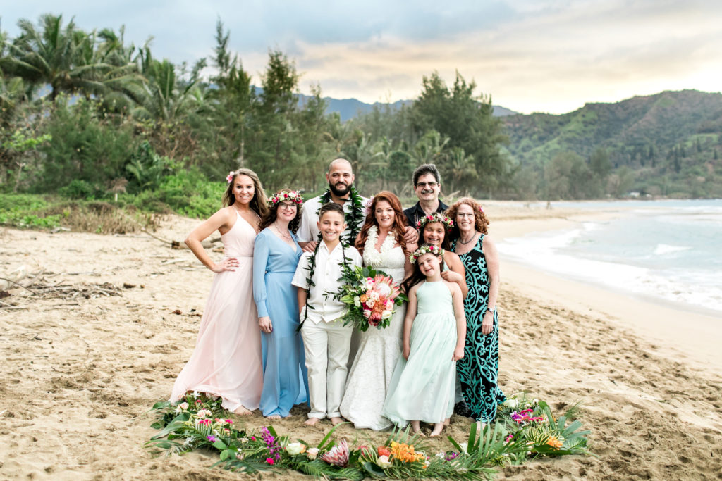 Family on the beach for a wedding in Hawaii.