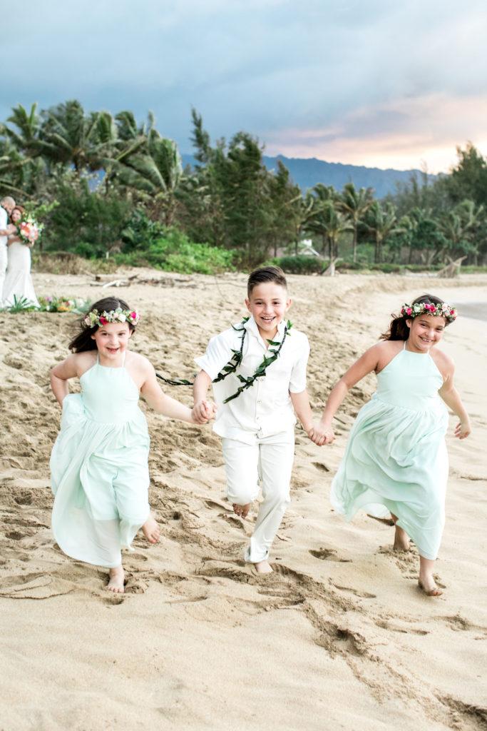 Children playing on the beach in Kauai.