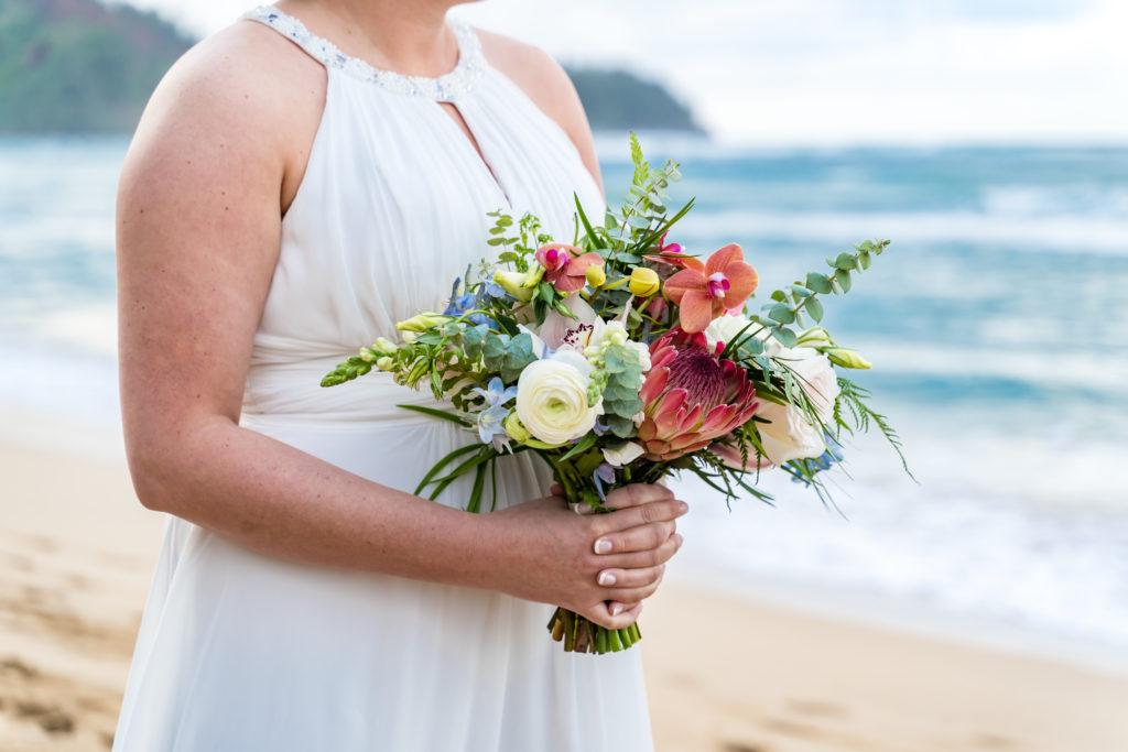 Bride with floral arrangement.