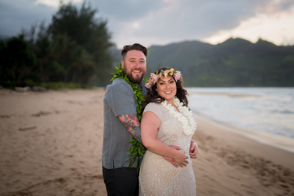 Bride and groom for their wedding on the beach.