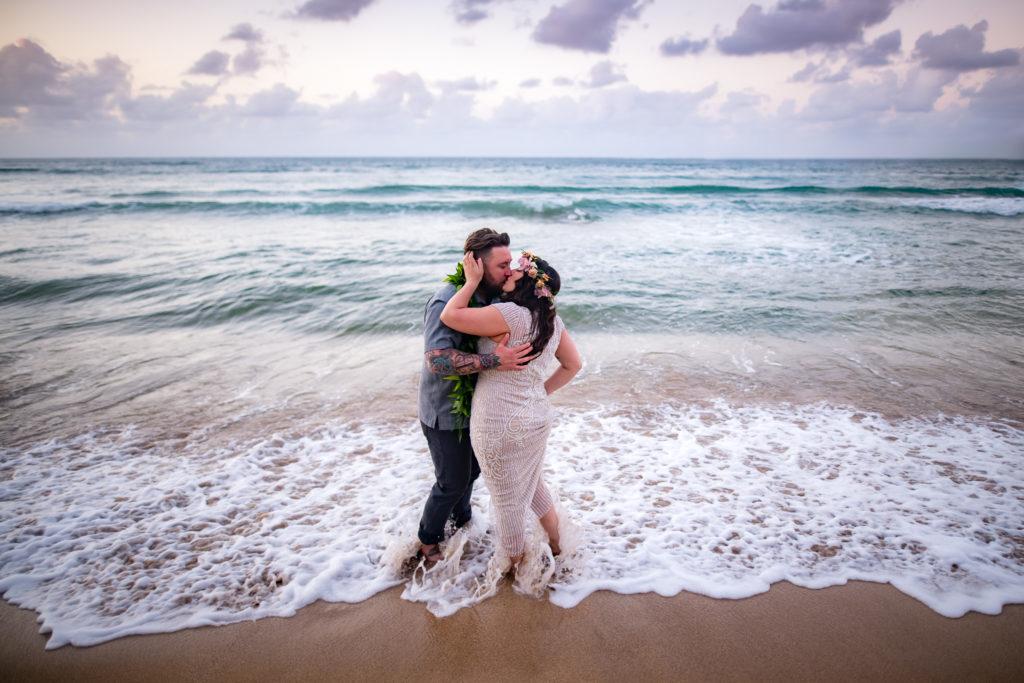 Alexis and Derek by the ocean in Kauai.