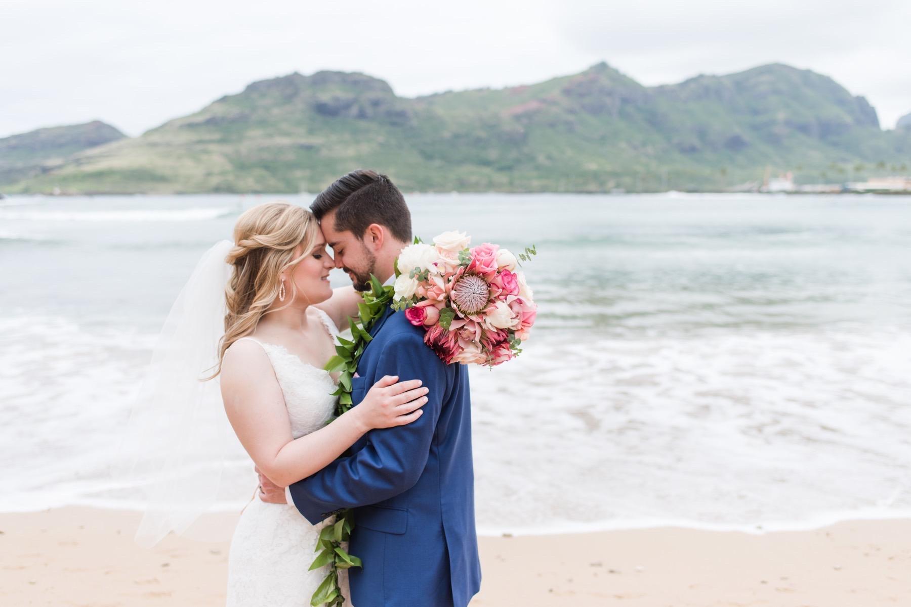 Alyssa & Ryan on the beach in Kauai.