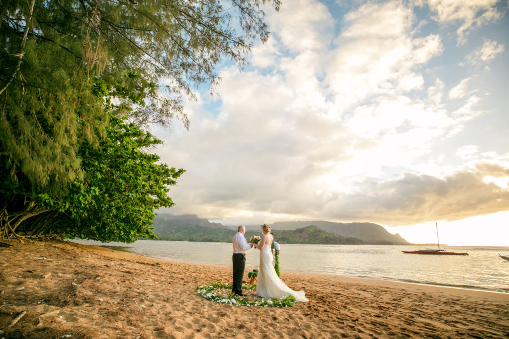 Bride and groom eloping on the beach.