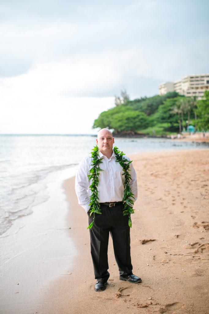 Groom on the beach in Hawaii.