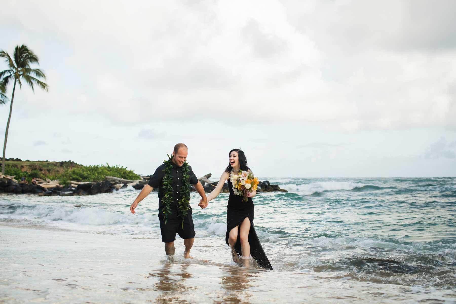 Erin & Matt in the ocean by the beach.