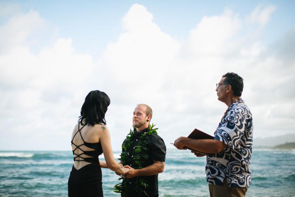 Couple eloping on the beach in Kauai.