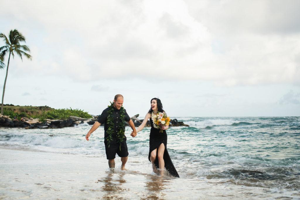 Bride and groom in the ocean.