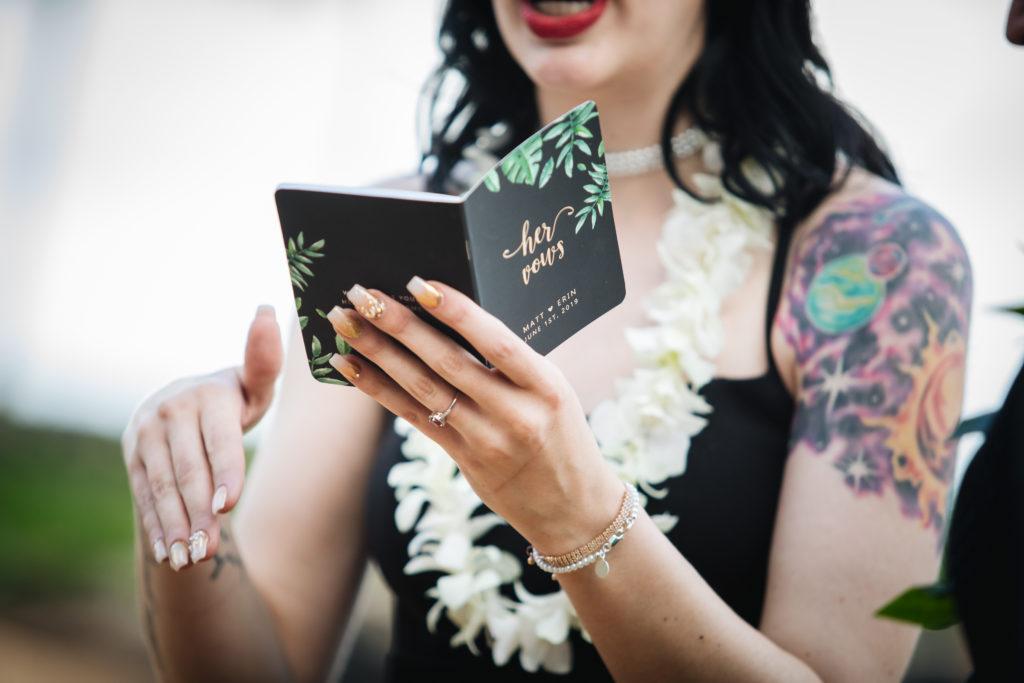 Bride reading her vows.