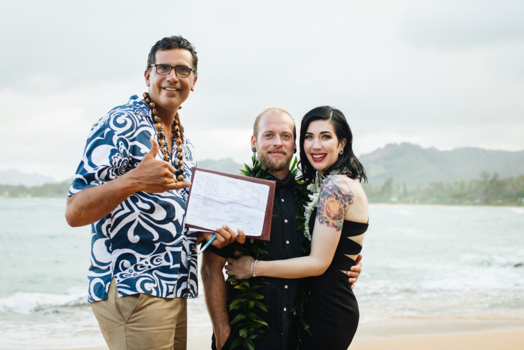 Getting married on the beach in Hawaii.