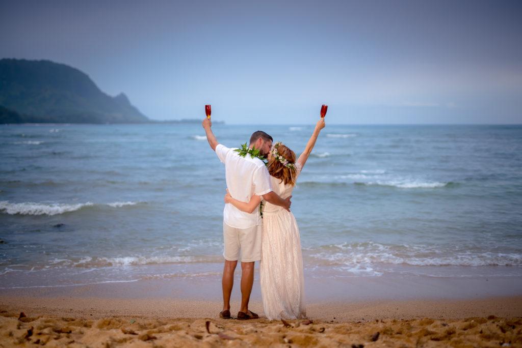 Husband and wife on the beach in Kauai.