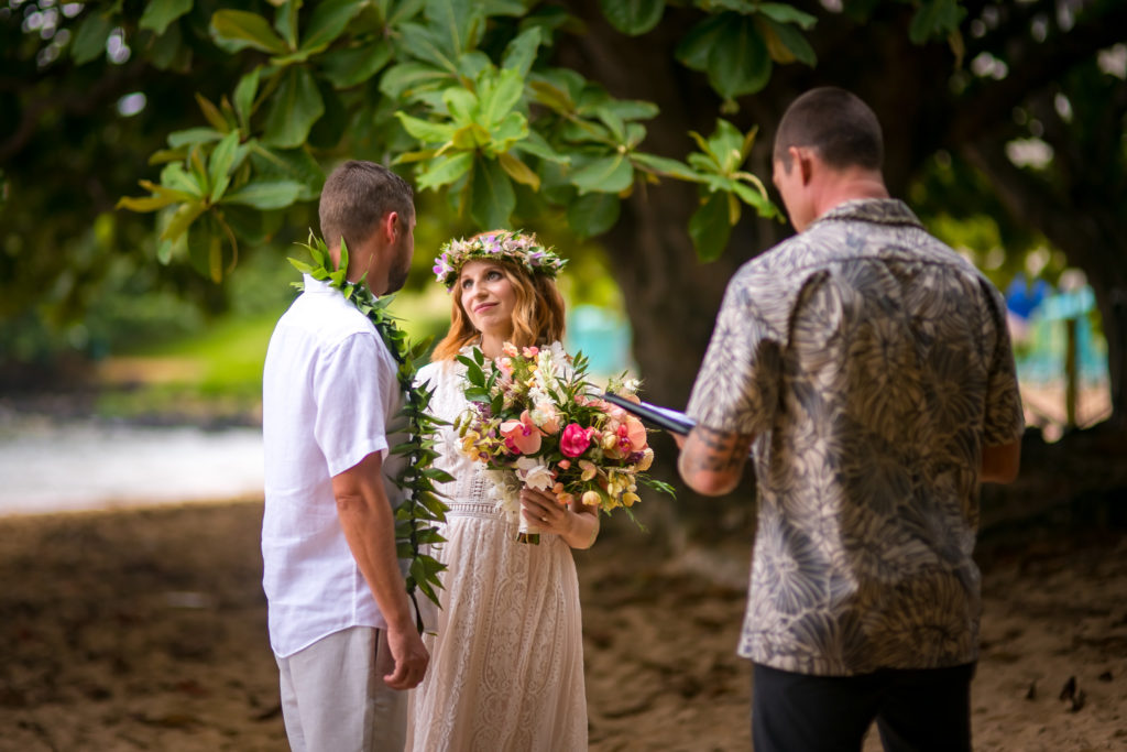 Bride and groom get married on the beach.