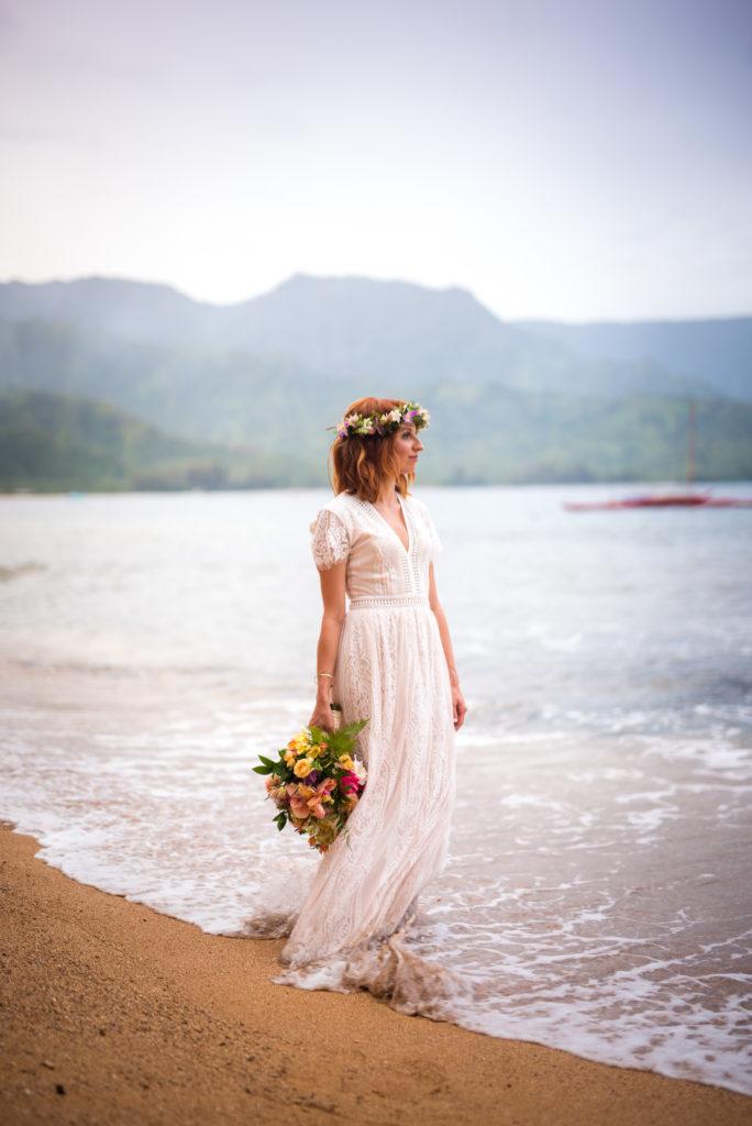 Bride with flower bouquet.