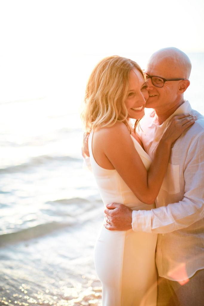 Bride and groom on the beach in Kauai.