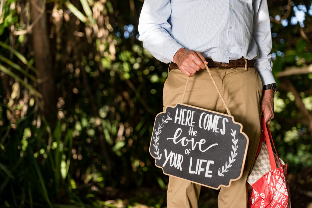 Man carry sign for wedding.