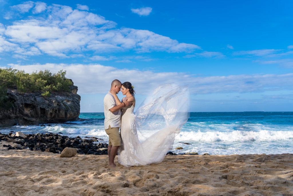 Bride and groom on the beach.
