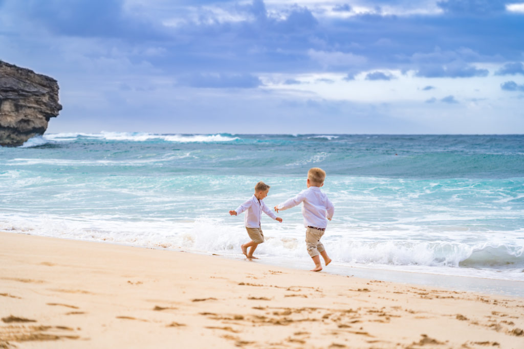 Young kids playing in the ocean.