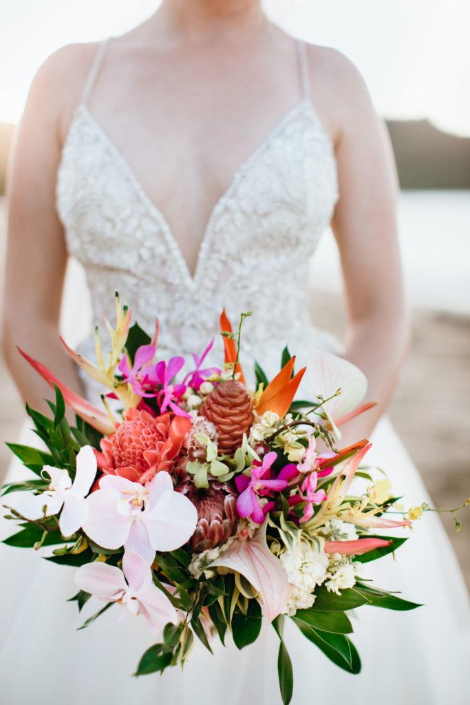 Bride holding flower bouquet.